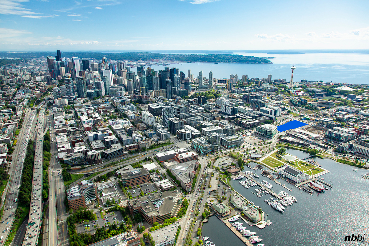 An aerial view of the project site showing the location between Lake Union, downtown and the Space Needle.